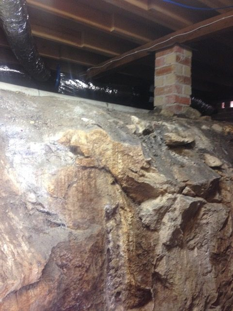 Water running off rock was causing a strong musty smell. We installed a ducted in-line fan to improve ventilation and solve this problem - Hornsby